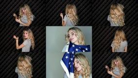 Closeupframsidan av en blond flicka för härlig sensualitet med makeup för blått öga överför en luftkyss lager videofilmer