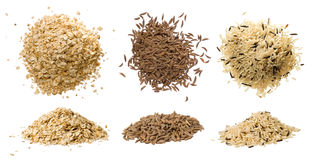Closeups of oatmeal, rice and caraway. Closeups of oatmeal flakes, long rice mixed with wild rice and dried caraway isolated on white stock photo