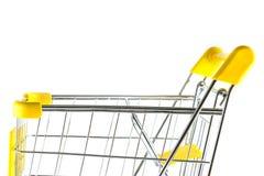 Closeupsidan beskådar shoppingvagnen på vitbakgrund Arkivfoto