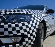 Closeupsikt av bilschackbrädemodellen med den detaljbillyktan och backspegeln Arkivbild