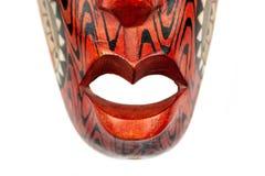 Closeupsikt av botten av den träröda maskeringen från Thailand som dekoreras med svartvita modeller arkivbilder