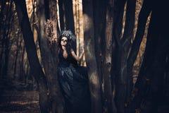 Closeupstående av Calavera Catrina i svart klänning Sockerskallemakeup de diameter los muertos död dag halloween arkivfoton
