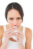 Closeupstående av en ung kvinna med den blödande näsan royaltyfria bilder