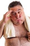 Closeupståenden av en exausted fet man, når det har gjort, övar Royaltyfri Bild