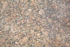 Closeuptextur av röd naturlig granit arkivbild