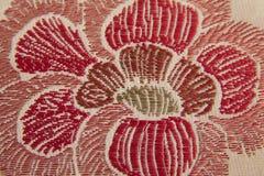 Closeuptyg med blommadetaljen royaltyfri bild