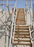 Closeview of the wooden and steel pipe ladder Royalty Free Stock Photos