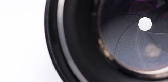 Closing aperture of camera lens. With lense reflections stock image