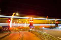Closing barrier at railway crossing Stock Photography