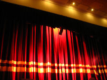 Closing Curtain. A red closing curtain on a stage Royalty Free Stock Photos