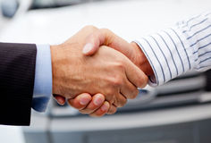 Closing deal on a car Royalty Free Stock Photos