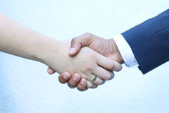 Closing deal - Shaking hands stock photo