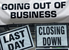 Closing down. Signs in high street shop window Stock Photography