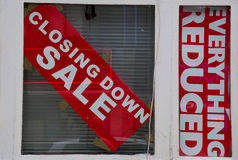 Closing down sale sign. In a window royalty free stock images