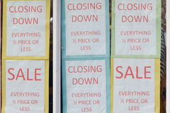 Closing Down Sale signs in shop window. To alert customers to bargains Stock Photos