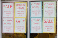 Closing Down Sale signs in shop window. To alert customers to bargains Royalty Free Stock Image