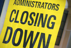 Closing down sign. Closeup of closing down sign in shop window stock photography