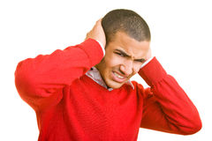 Closing the ears. Young man closing his ears Stock Photography