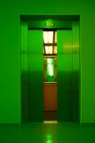 Closing elevator doors. Elevator doors closing in green light; soft focus Stock Photography