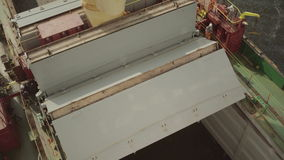 Closing the Hatch of Hold on a Cargo Ship stock video