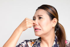Closing her nose. Asian woman closing her nose Royalty Free Stock Images