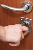 Closing house door by key Stock Images