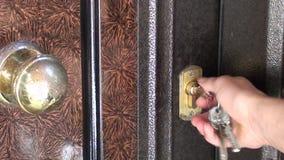 Closing and locking door stock video footage