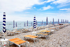 Closing parasols on the stony beach of Fossacesia (Italy) royalty free stock image
