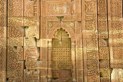 Closing in on Qutub Minar. Ultra close-up view of inscriptions and intricate design on outer wall of Qutub Minar, Delhi, India, Asia Royalty Free Stock Image