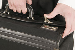Closing the suitcase Royalty Free Stock Images