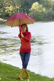 Closing umbrella Stock Images
