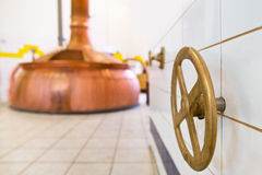 Closing valve in the brewery. Old copper closing valve in the brewery Stock Image