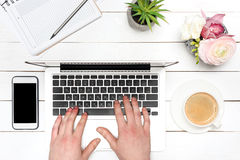 Closperson typing on laptop at workplace Royalty Free Stock Photography