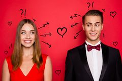 Closr-up portrait of two nice chic lovely attractive imposing cheerful funny flirty people wearing dress and bow tux. Looking at each other thinking over bright stock photography