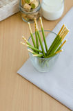 Closse up of green tea biscuits stick in glass Royalty Free Stock Photo