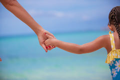 Closup hands of mother and daughter walking on the Royalty Free Stock Images