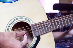 Closup Playing the Guitar. Closup man Playing the Guitar Stock Image