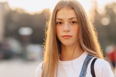 Closup portrait attractive pretty girl with briefcase walk on st stock image