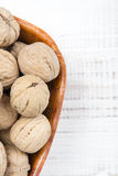 Closup of a walnuts in a bowl. Closup of a walnuts in a bow on wooden background with copy space Royalty Free Stock Images