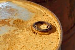 Closure of the barrel, rusty barrel lid. Stock Photos