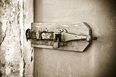 Closure of an old wooden door - safety concept image Royalty Free Stock Images