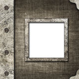 Cloth album cover with an iron rootlet and frame for photo Stock Photography