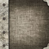 Cloth album cover with an iron rootlet Royalty Free Stock Photos