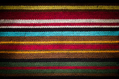 Cloth background. Multi colored striped fabric background close up stock photography
