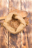 Cloth bag with buckwheat groats Stock Photography