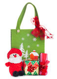 Cloth bag with Christmas decorations and gifts boxes Royalty Free Stock Photos