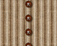 Cloth bottons. Wooden Cloth buttons on brown shirt Stock Photo