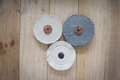 Cloth buffer wheel on the wooden background Stock Photos