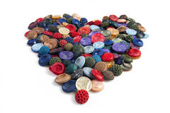 Cloth buttons forming a heart. Many colorful cloth buttons forming the shape of a heart Stock Image