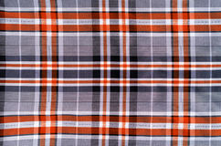 Cloth in a Cage. Fabric Texture as Background Stock Photography